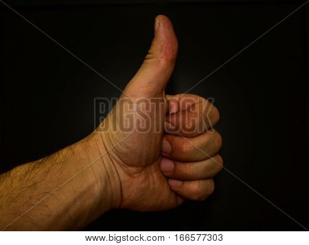 thumbs up on a black background good