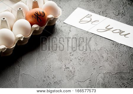 concept of correct choice eggs on dark background top view.
