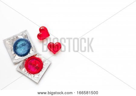concept male contraception condom on white background top view.