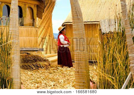 UROS FLOATING ISLANDS PERU - SEPTEMBER 18: Indigenous woman on the Uros Floating Islands Peru on September 18 2014