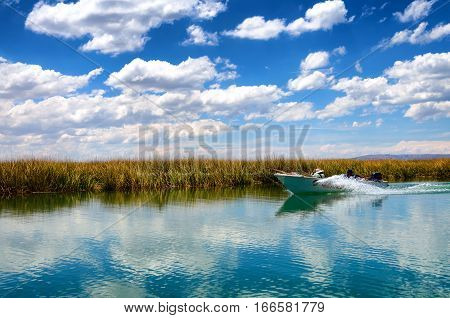Boat passing through the canals on Lake Titicaca in Peur