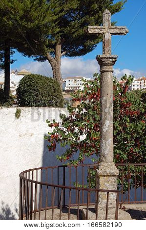 Stone cross outside the Marquis of Salvatierre`s House in Ronda, Andalucia, Spain