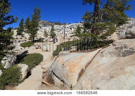 OLMSTED POINT, YOSEMITE NATIONAL PARK - SEP 23: Visitors gather at Overlook Trail on Sep 23, 2015 at Olmsted Point, Yosemite National Park. Olmsted Point is a viewing area off of Tioga Road which offers views into Tenaya Canyon.