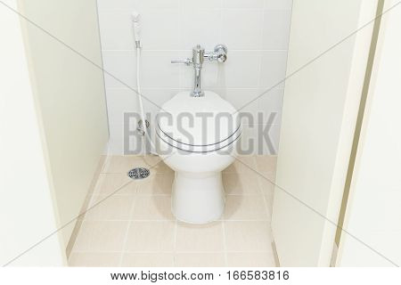 White water closet and tile floor in toilet room.