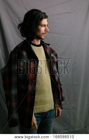 Portrait of a hairy hipster. Young handsome guy posing