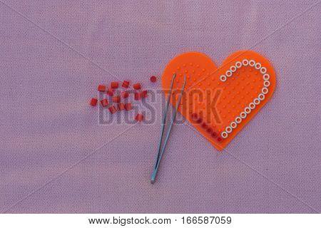 Heart shape pixel art make from pixel bead.