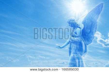 Beautiful angel in heaven with divine rays of sun light