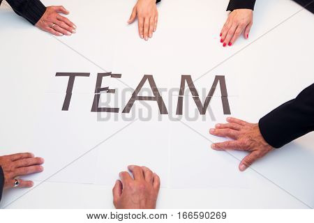 concept shot of a  business team contributing to create the bigger picture.