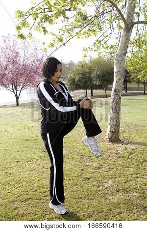 Fit African American woman exercising at the park