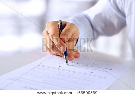 Businessman is signing a contract business contract details