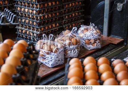 Closeup of many fresh brown eggs in carton tray packeging egg for sale