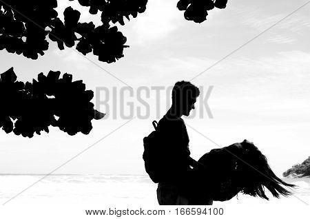 Couple enjoying the beach. BW stock image.