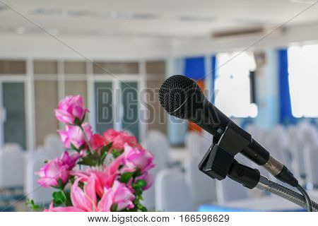 microphone on stand Close up in conference room :Select focus with shallow depth of field.