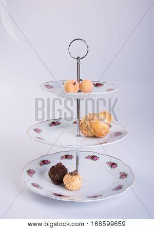 Tray Or Three Tier Serving Tray With Dessert On Background.
