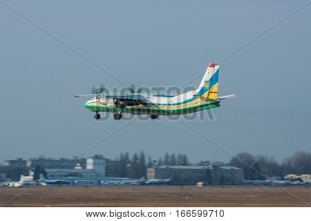 Kiev Ukraine - March 15 2011: Ukraine Border Guard Antonov An-24RV plane takeoff from the airport in the afternoon