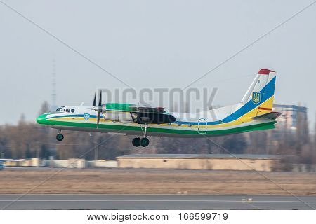 Kiev Ukraine - March 15 2011: Ukraine Border Guard Antonov An-24RV plane on a takeoff roll