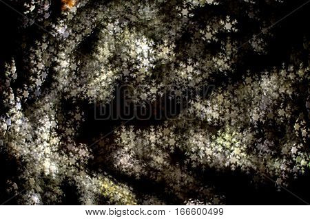 A group of bright white beautiful six pointed stellar dendrites snowflakes on a dark background bokeh effect