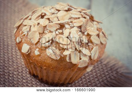 Vintage Photo, Fresh Muffin With Oatmeal Baked With Wholemeal Flour, Delicious Healthy Dessert