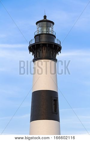 The Bodie Island Lighthouse stands tall over the Outer Banks of coastal North Carolina at Cape Hatteras National Seashore.