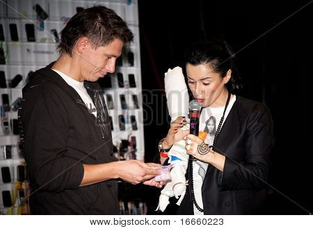 MOSCOW, RUSSIA, AUGUST,30: Russian Television Anchorwoman Tina Kandelaki and Showman Timur Batrutdinov at the Action - Day Without a Cellphone,  August 30, 2009 at Moscow, Russia