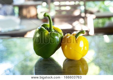 Mexican Hot Chili Peppers Colorful  On Table Wood And Glass