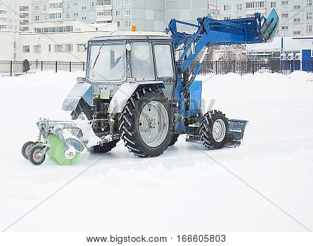 tractor clears snow on the ice rink a tractor cleans the ice