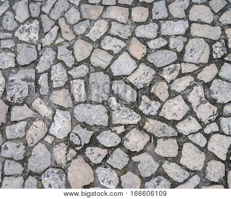 Stone block road pavement as texture  close up