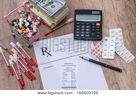pills money syringe insulin. rx on desk