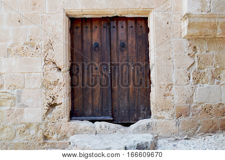 Vintage wooden door - a fragment of an ancient monastery. Cyprus. Aya Napa