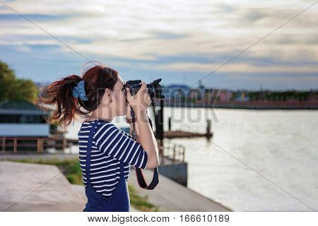 Beautiful Photographer Taking A Photo Near Chao Phraya River In Bangkok, Thailand.