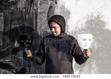 Asian Man Chooses Between Black And White Mask In Scary Abandoned Building, Human Face Expression, G
