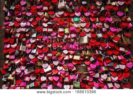 VERONA, ITALY - MAY 1, 2016: Verona - Lover locks and master key locks closed up at Casa di Giulietta (in front of Juliet's Balcony). People believes this would help blessing in their love lives.