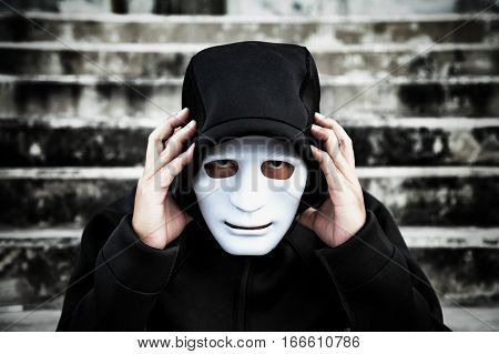 Asian Man In The Black Hood And White Mask With Confused Depression Sitting On Stairs, In Scary Aban