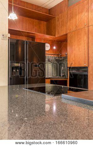 Marble Countertop In Wooden Kitchen