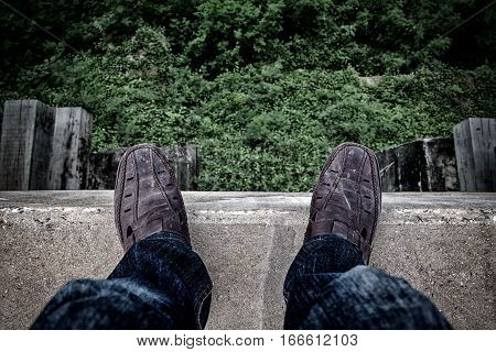 Suicide Concept., Depressed Young Man Looking Down At His Shoe And Contemplating Suicide., On The Ed
