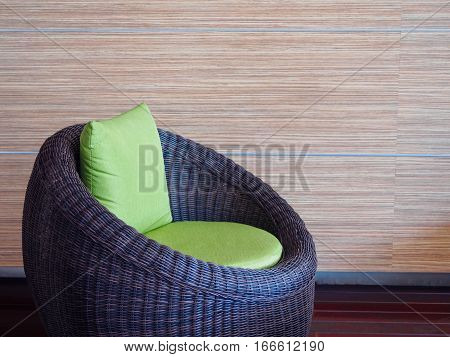 The Patio set Furniture with green pillow