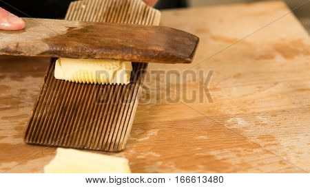 Butter Kneaded And Rolled With Grooved Wooden Paddles