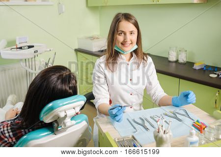 Female Dentist Working At Dental Clinic With Female Patien