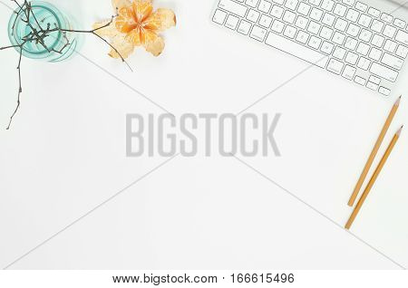 Minimal elegant desk composition flat lay with tangerine and coffee