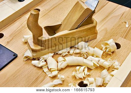 Handed Planer On Carpentry Table And Shavings