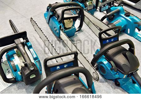 The chain saws in the store closeup