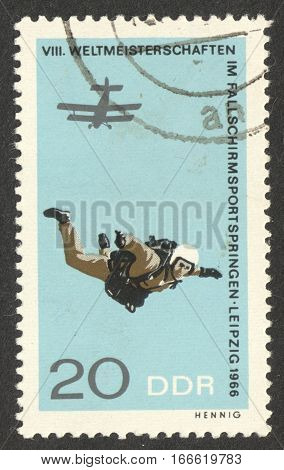 MOSCOW RUSSIA - CIRCA DECEMBER 2016: a post stamp printed in the DDR shows a parachutist the series