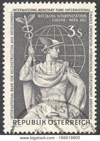 MOSCOW RUSSIA - CIRCA DECEMBER 2016: a post stamp printed in AUSTRIA shows Mercury and Globe dedicated to the World Bank Congress in Vienna circa 1961