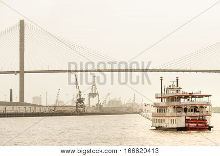 Paddle-wheeler cruising towards Talmadge Memorial bridge and Port of  Savannah, GA