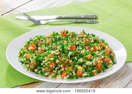 Tabbouleh Parsley Salad On White Platter On Table Mat
