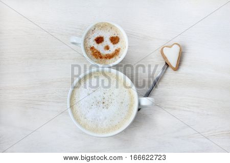 jolly snowman made from coffee cups waving gingerbread heart / with best wishes