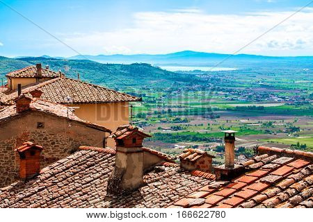 View of the Val di Chiana from the roofs of Cortona in Tuscany Italy