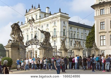 PRAGUE SEPTEMBER 15: The crowd of tourists near Archbishop's Palace on the Castle Square near the main entrance in The Prague Castle on September 15 2014 in Prague Czech Republic.