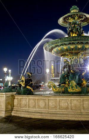 PARIS FRANCE MARCH 15 2012: Fountain in Place de la Concorde at night on March 14 2012 in Paris France