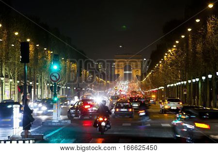 Night fires of cars on the Champs Elysee. Paris